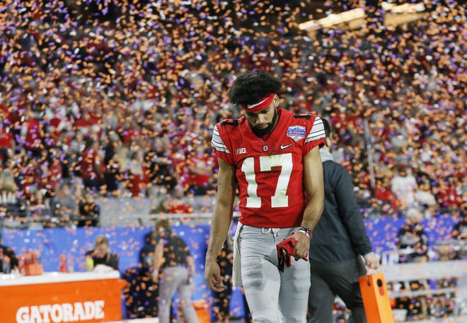 Ohio State receiver Chris Olave walks off the field following the College Football Playoff semifinal loss to Clemson on Dec. 28. He's anxious to atone for his part in a late game interception that sealed OSU's fate.