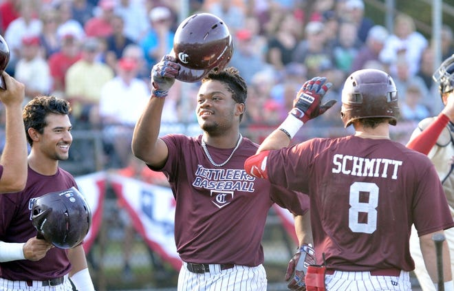 Oraj Anu, center, celebrates with his Cotuit Kettleer teammates after hitting a home run during the 2019 Cape Cod Baseball League Championship Series. It was announced recently that Major League Baseball is creating a summertime minor league for top collegiate prospects, which may hurt established summer talent outposts such as the Cape Cod Baseball League.