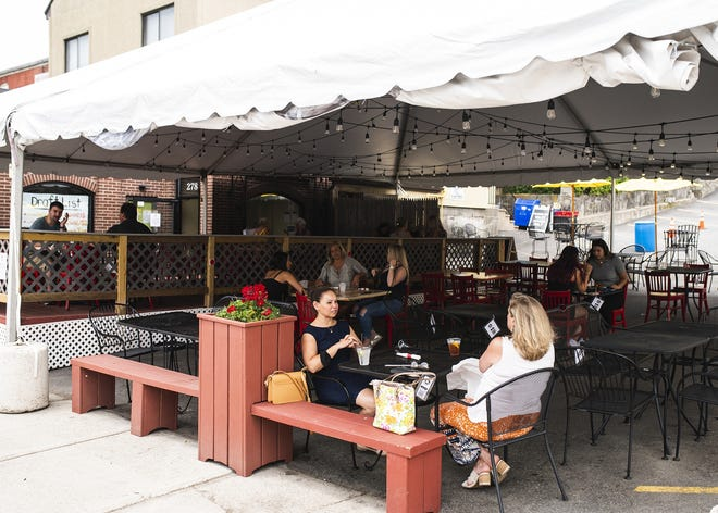 Customers dine outdoors at the Flying Rhino on Shrewsbury Street in July.