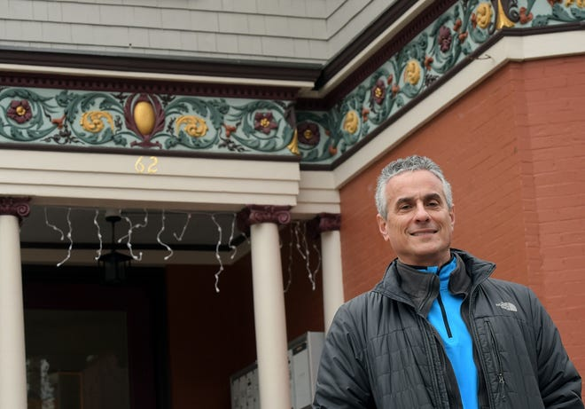 Russ Haims stands at a house on Cedar Street he redeveloped in Worcester.