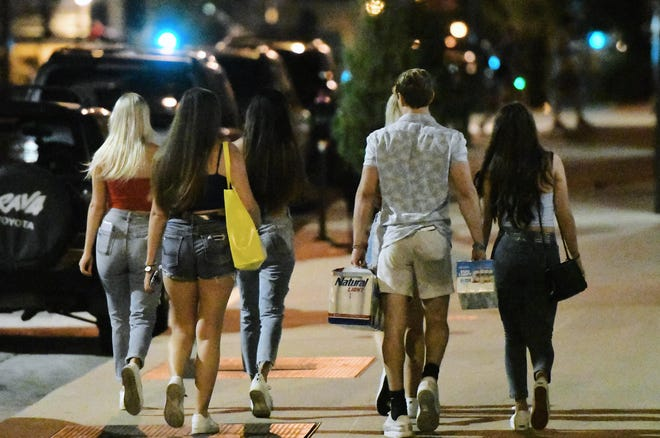 Students leave the Brookside Apartment Complex located downtown on Aug. 6. Music could be heard coming from multiple areas inside of the apartment complex on Sunday evening.