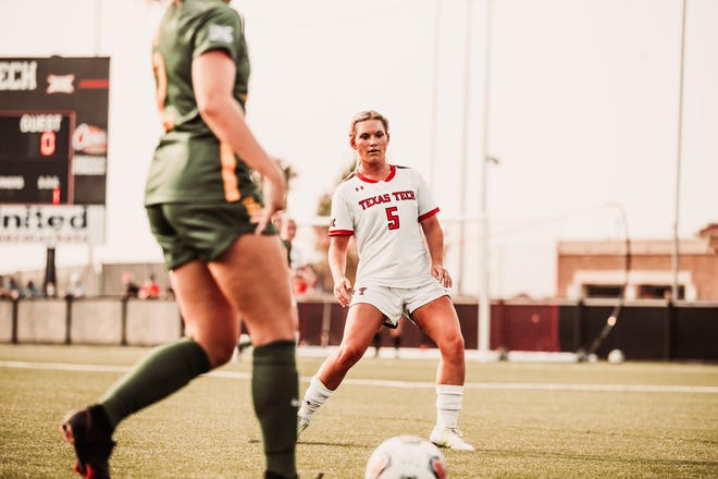 Texas Tech's Charlotte Teeter (4) battles for the ball against Baylor's Gabby Mueller (7) during a Big 12 Conference match Friday at the John Walker Soccer Complex. Both teams battled to a scoreless tie in double overtime.