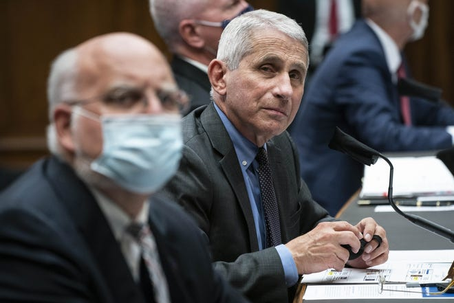 Dr. Robert Redfield, director of the Centers for Disease Control and Prevention, left ,Director of the National Institute of Allergy and Infectious Diseases Dr. Anthony Fauci.