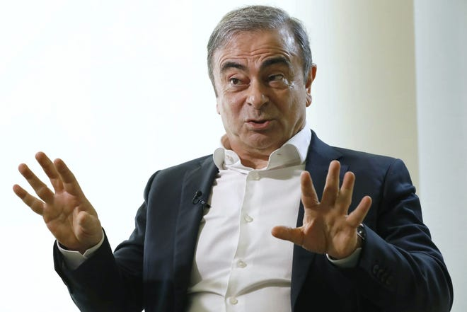 In this Jan. 10  file photo, former Nissan Chairman Carlos Ghosn speaks to Japanese media during an interview in Beirut.