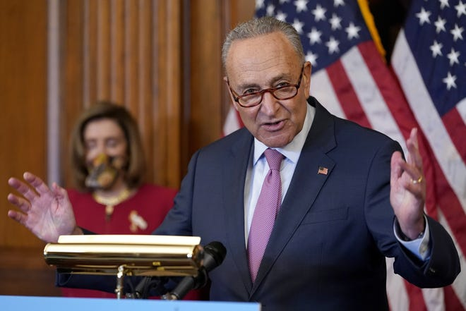 Senate Minority Leader Sen. Chuck Schumer of N.Y., speaks during a news conference as House Speaker Nancy Pelosi of Calif., looks on in Washington.