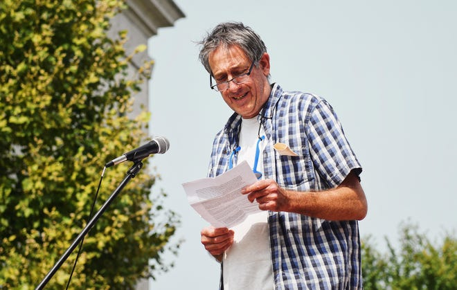 Fourth Ward council member Ian Thomas speaks during a Walk for Climate rally last year.
