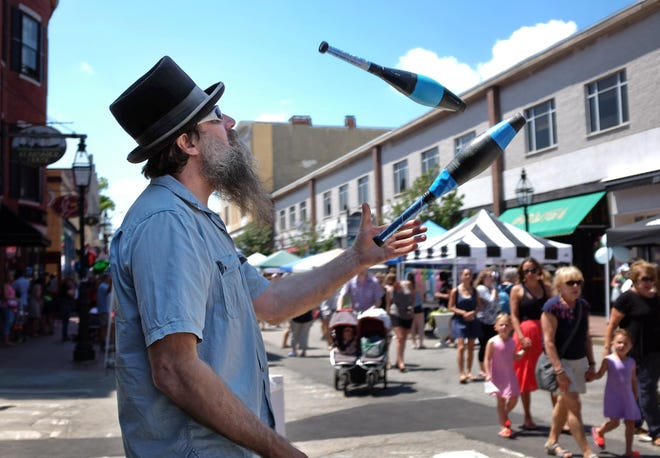 Pete Spofford juggles at the corner of Congress and Chestnut streets during Pro Portsmouth's 40th annual Market Square Day. The 2021 event will be held Saturday, Sept. 18.