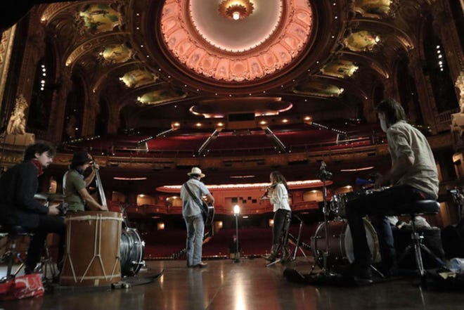 The Mammals, gathered by a ghost light, play to the empty seats of the Wang Theatre.