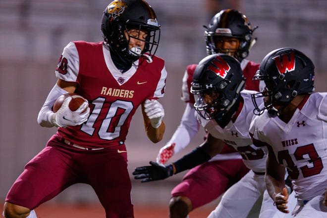 Rouse wide receiver Jalen Becerra attempts to evade Weiss defenders during a game last season. The senior tallied 42 catches for 921 yards and 13 scores for the Raiders last year.
