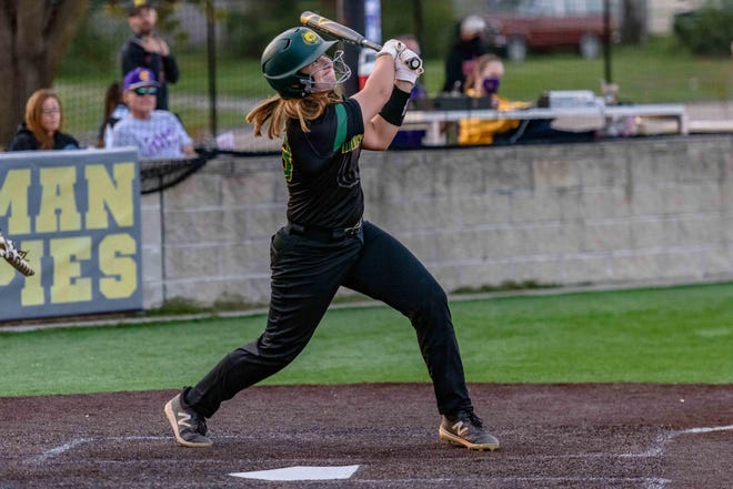 Rock Bridge's Abby Hay (23) follows the path of her second home run during a game against Hickman last season at Hickman High School.