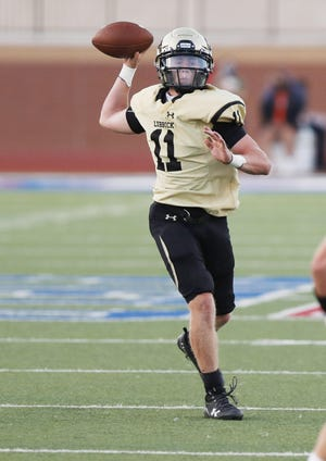 Lubbock High's Brandon Smith (11) passes downfield during the first half of a nondistrict game Thursday against Big Spring at PlainsCapital Park at Lowrey Field.