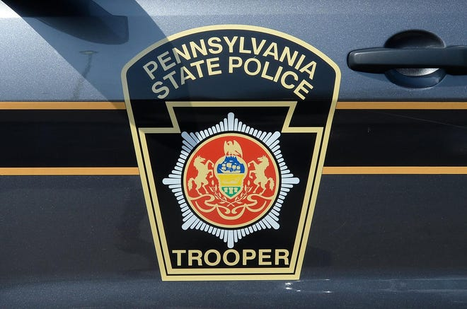 This is a file photo of a Pennsylvania State Police SUV is parked outside the Troop E headquarters in Lawrence Park Township.