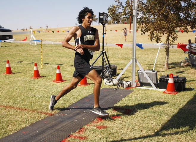 Lubbock High's Isaac Alonzo crosses the finish line to win the Classes 5A through 6A boys race during the Lubbock ISD Cross Country Invitational on Oct. 10, 2020 at Mae Simmons Park. For the second straight year, Alonzo completed an undefeated regular season by winning the LCU Chap Invite on Saturday.