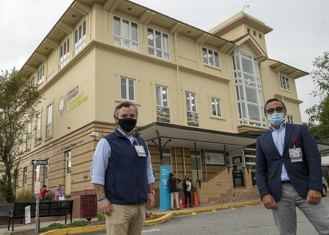 Stephen Kerrigan, president and CEO, left, and Jose Ramirez, vice president of operations, stand in front of the Kennedy Community Health Center Wednesday.