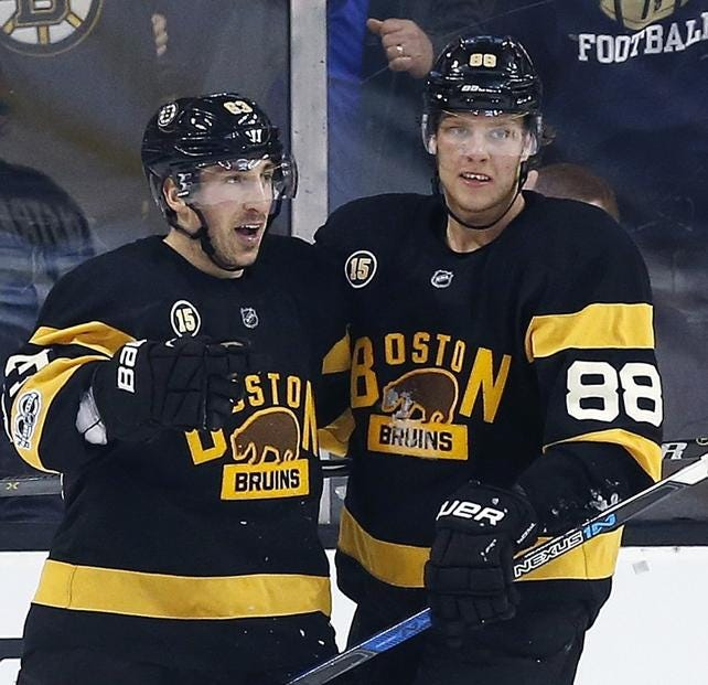 Bruins forwards Brad Marchand, left, and David Pastrnak both underwent major surgery in the fall that will likely prevent them from starting the new season on time.