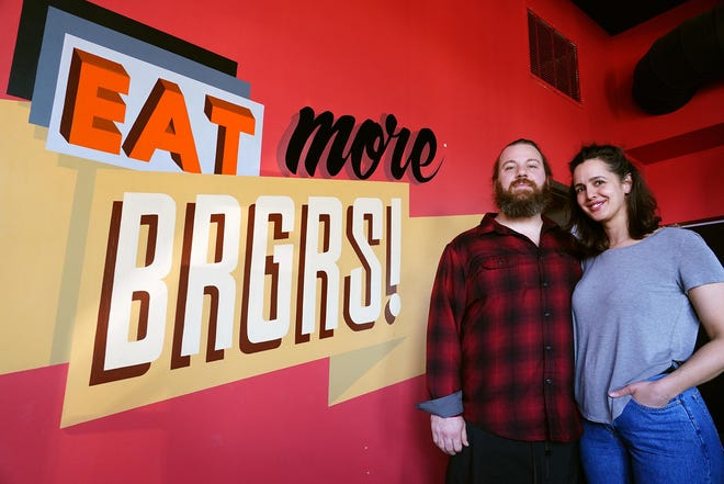 Jason and Carolyn Dagostino, owners of the BRGR Bar in Portsmouth.