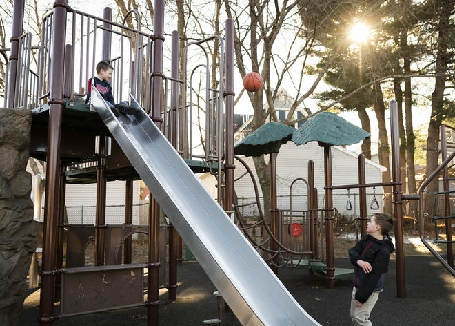 Children play at Duffy Field, also known as Wetherell Estate Park, in Worcester in February.