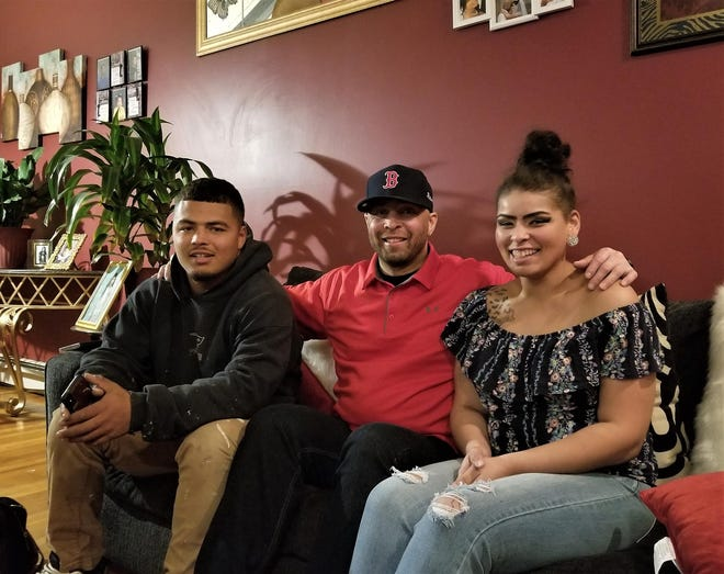 Jhamal Gonsalves, left, with his father, Mark, and sister Khayla Gonsalves, in a 2019 file photo.