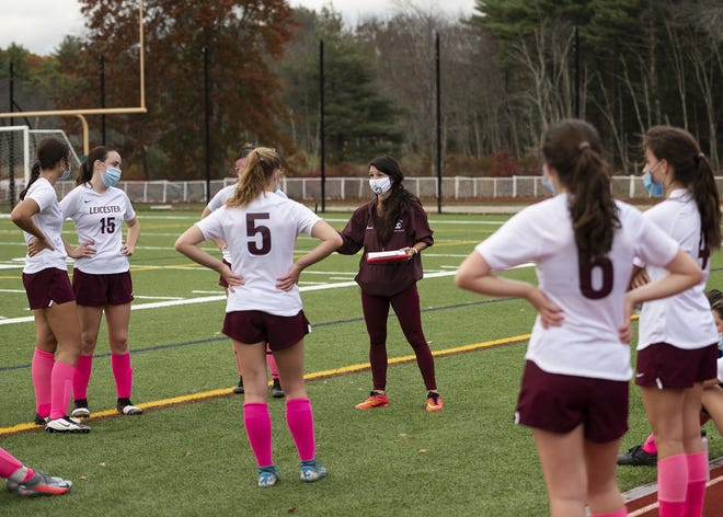 Leicester girls' soccer coach Autumn Connor addresses her team at a safe distance during a recent game.