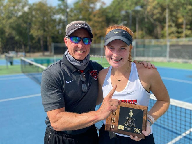 Northside senior tennis player Kate Files, right, poses with Northside tennis coach Martin Hyatt after Files claimed the championship Tuesday in the Overall state girls singles tournament at North Little Rock.