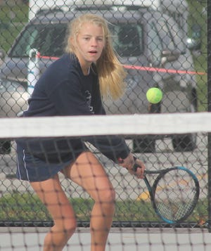 Notre Dame girls tennis player Mary Breitbach competes last season at the Class 1A Geneseo Sectional.