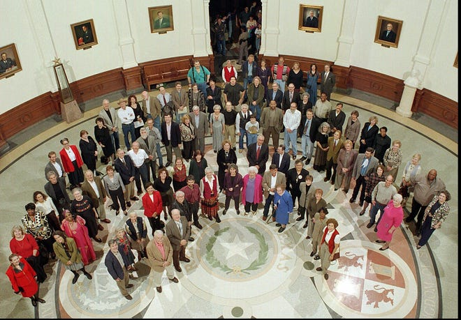 Texas authors gather in the Capitol Rotunda for a group picture commemorating the first annual Texas Book Festival in 1996. The fest had planned to have more in-person, outdoor events this year but has shifted back to mostly virtual.