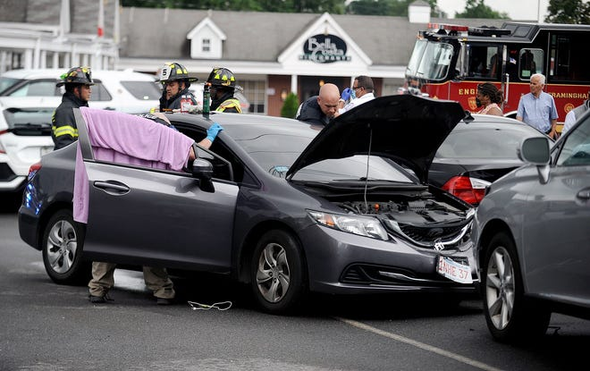 Police and firefighters respond to the scene of a car crash Monday afternoon on Royce Road in Framingham.