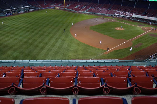 Empty seats sit in a Fenway Park without fans during the fourth inning of a game against the Baltimore Orioles this past season.