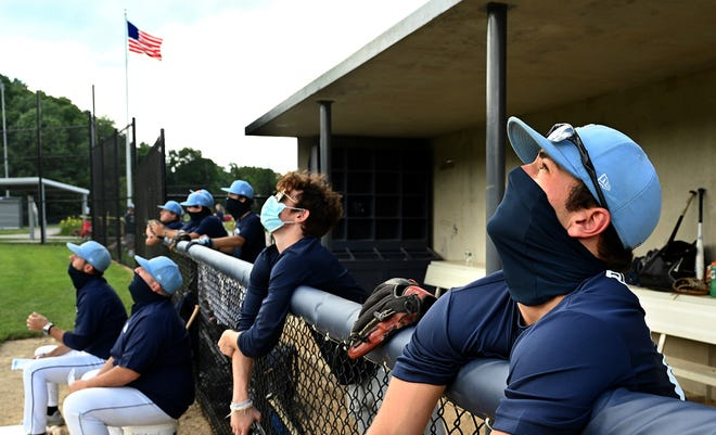 Franklin baseball players and coaches where masks in the dugout during a Massachusetts Independent Baseball League game last summer.