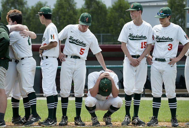 Hopkinton's Josh Fischer (5) lends some support to former teammate Ryan Kester as the team lines up following a 2-0 loss to St. Mary's of Lynn in the Div. 2 state championship game at Alumni Field in Lowell in 2019. Fischer helped Hopkinton to a 2-0 win over Milton on Monday to secure a return trip to the D2 state title game for the Hillers this spring.