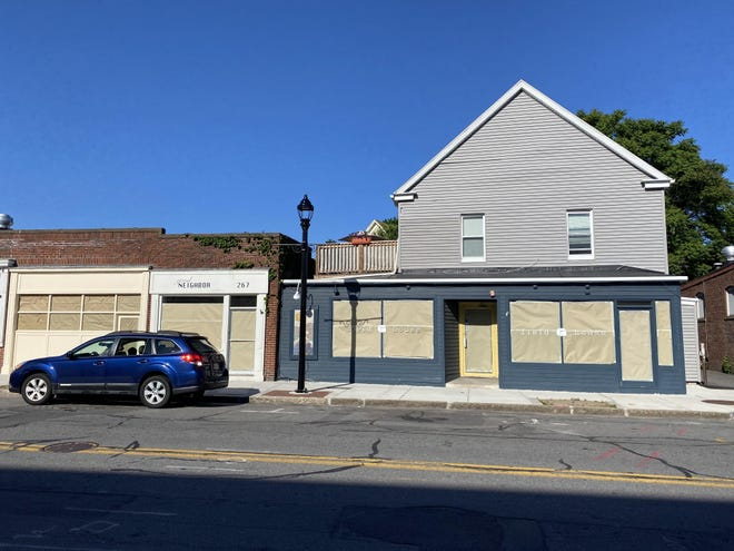 The storefronts of Beaux Biens, Good Neighbor and Field House on Cabot Street in Beverly are covered with paper after the owners announced they would all be closing permanently.