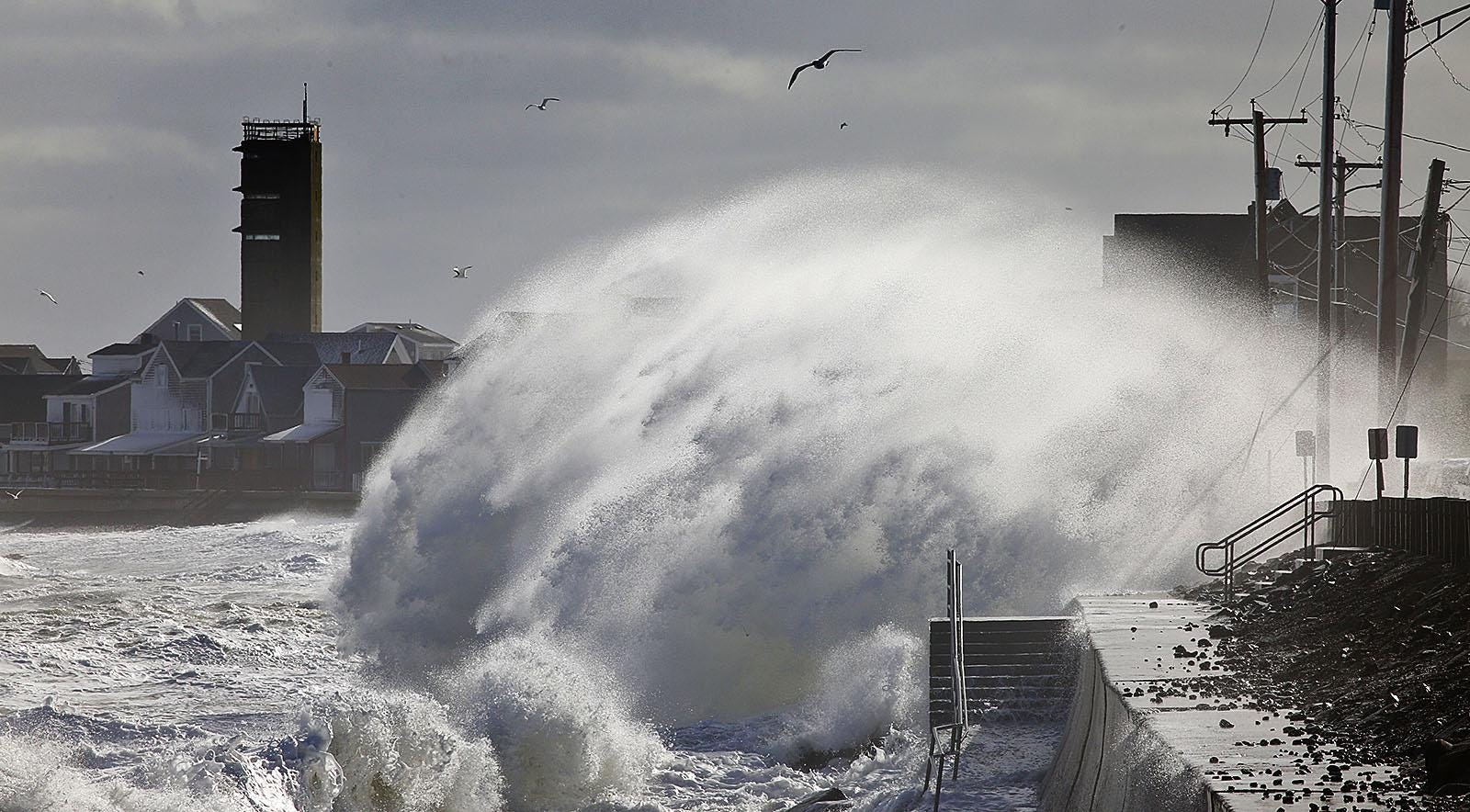 Spray soars as a big wave hits the seawall in the Ocean Bluff section of Marshfield during a Jan. 2016 storm.