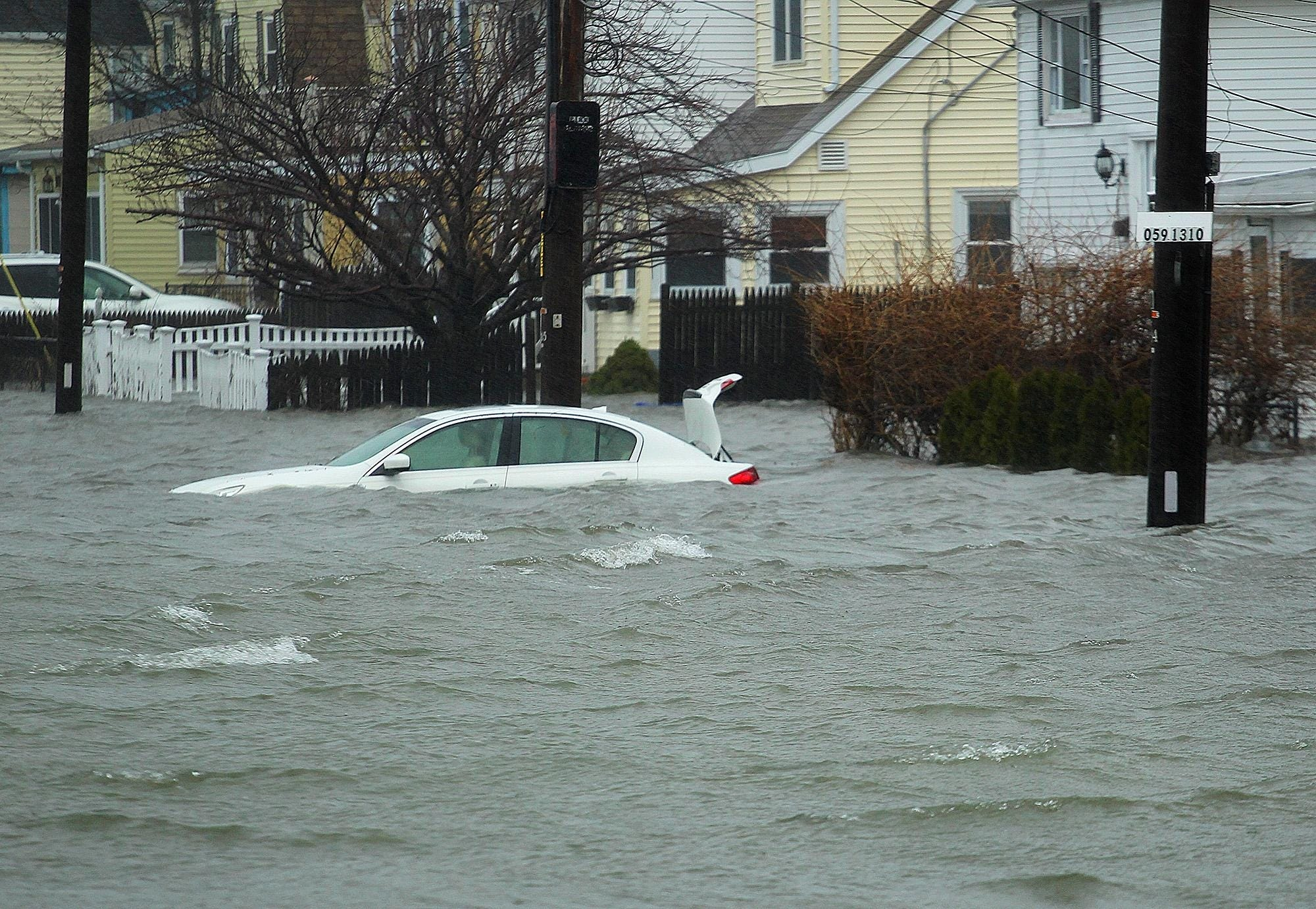 A car on Sea Street in Quincy is under several feet of water during a March 2018 nor'easter. File Photo/The Patriot Ledger