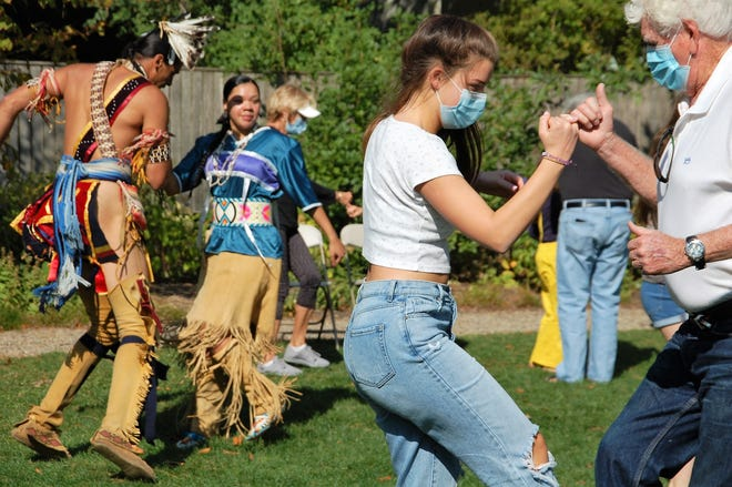 Audience members join in with the Wampanoag Nation Singers & Dancers during the Indigenous Peoples Day celebration at the Jeremiah Lee Mansion, Saturday Oct. 10, 2020.