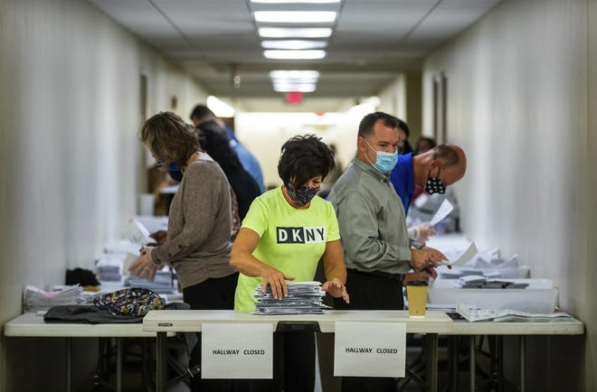 Jeri Shuits, center, office manager for the Beaver County Board of Elections, prepares ballots for counting last month in the basement of the Beaver County Courthouse in Beaver, Pa.