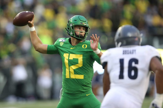Oregon quarterback Tyler Shough (12) is still running the first-team offense but didn't get a chance to separate himself in the competition with Anthony Brown when last Saturday's scrimmage was canceled due to five positive COVID-19 antigen tests within the program, which turned out to be false positives. (Chris Pietsch/The Register-Guard)