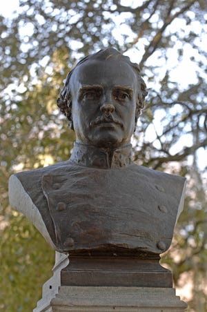 A bust of Confederate officer Francis S. Bartow sits atop a granite pillar at the foot of the Confederate Memorial monument in Forsyth Park. It was originally located in Chippewa Square.