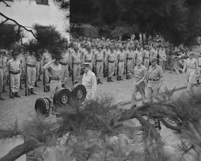 Gen. Douglas MacArthur leaving ceremony in Japan, Sept. 11, 1945 after American troops entered Tokyo city.