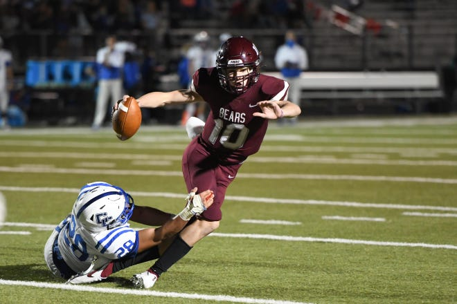 Bastrop's Seth Mouser eludes pressure and looks down the field during a game versus rival Cedar Creek last season.