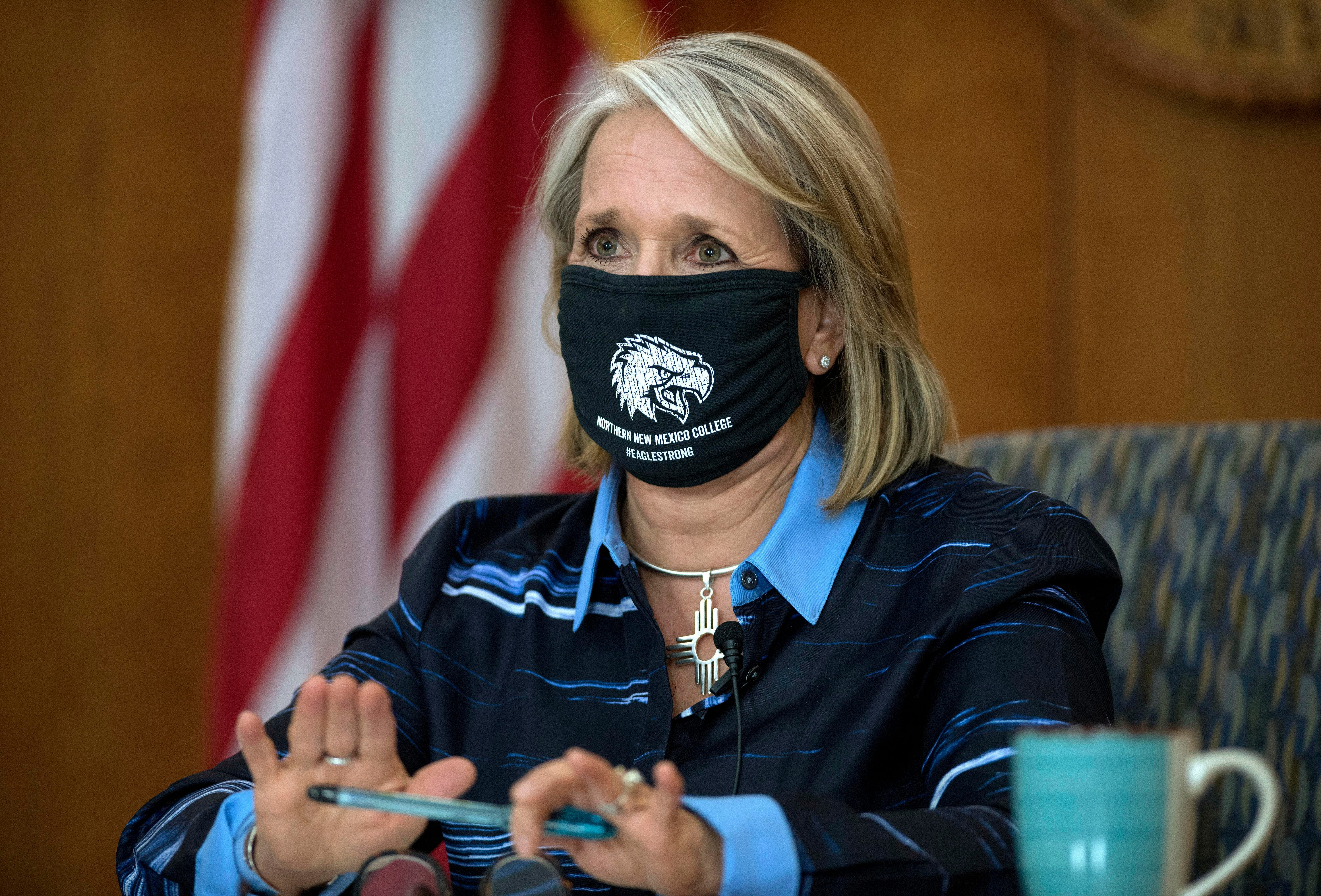Gov. Michelle Lujan Grisham gives a weekly update on COVID-19 and the state's effort to contain it during a virtual news conference from the state Capitol in Santa Fe, N.M.