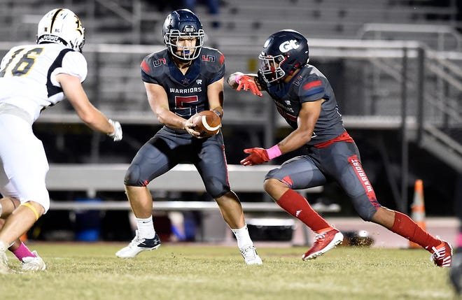 Grovetown running back Joseph Jean takes a handoff during the 2020 football season. Now a junior, Jean rushed for 213 yards and two touchdowns in Grovetown's 34-16 win over Greenbrier last week.