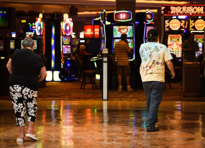 Guests make their way to the machines as Turning Stone Resort Casino.