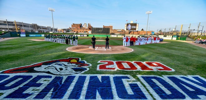 The Peoria Chiefs lined up at Dozer Park for their 2019 Midwest League Opening Day. The artwork on the turf will soon change to 2020.