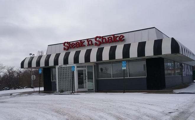 The former Steak 'n Shake restaurant at 7715 N. University St. in Peoria is being offered at auction, after being closed for the better part of two years.