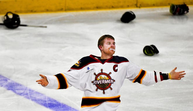 Alec Hagaman of the Peoria Rivermen acknowledges the applause of the crowd after a fight that took him off the ice during a SPHL game with the Quad City Storm at Carver Arena.