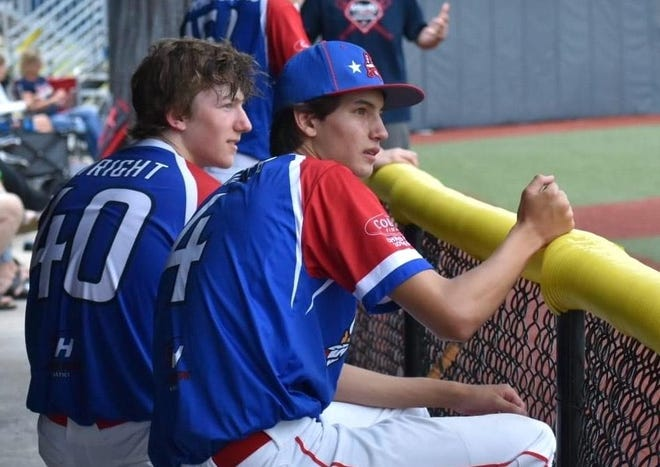 Aaron Miller, right, sits with his KHawks teammates during a baseball game. Miller, 16, died in an automobile accident Wednesday night.