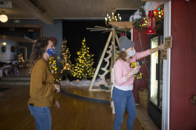 Emily Hurd, right, Emma Spahr put the finishing touches on The Norwegian's reconfigured dining room on Friday. The changes make room for an indoor market.