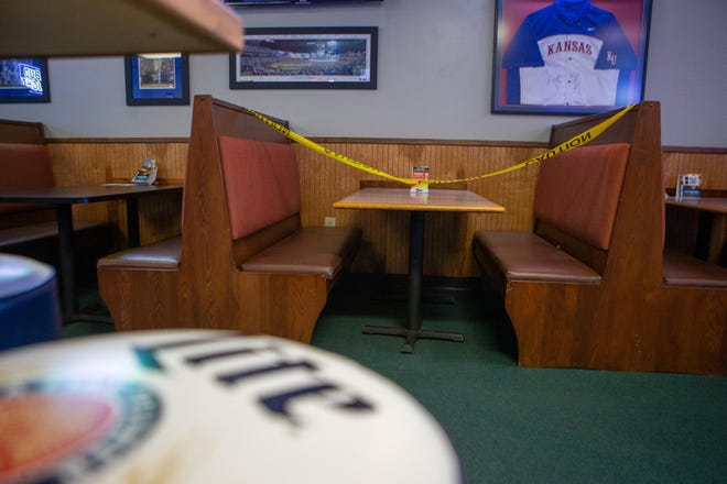 Sectioned-off tables — like the one pictured here at Skinny's Sports Bar and Grill, 4016 S.W. Huntoon St. — are a common sight during the pandemic, as restaurants and bars are forced to operate at a limited capacity to allow for social distancing.