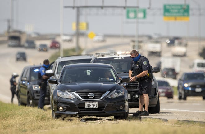 Austin police officers pull over drivers on East Ben White Boulevard in 2020. Black and Hispanic motorists are overrepresented in traffic stop searches in both Austin and Hutto.