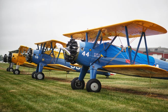 Several Stearman planes that are in Galesburg this week sit grounded by rainy conditions Wednesday at Galesburg Municipal Airport.